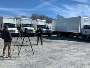 Derek Whaley of Roush CleanTech describes his company's role in repowering some of McAbee's vehicles with the propane system.